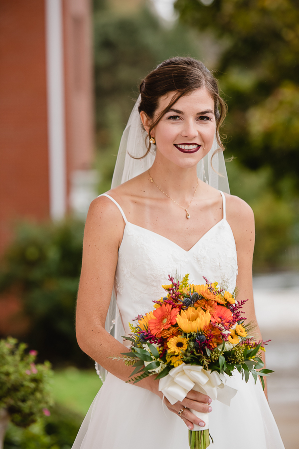 Beautiful Bride with Colorful Fall Bouquet