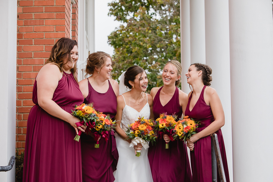 Bride and Bridesmaids in Burgundy Dresses with Colorful Fall Bouquets