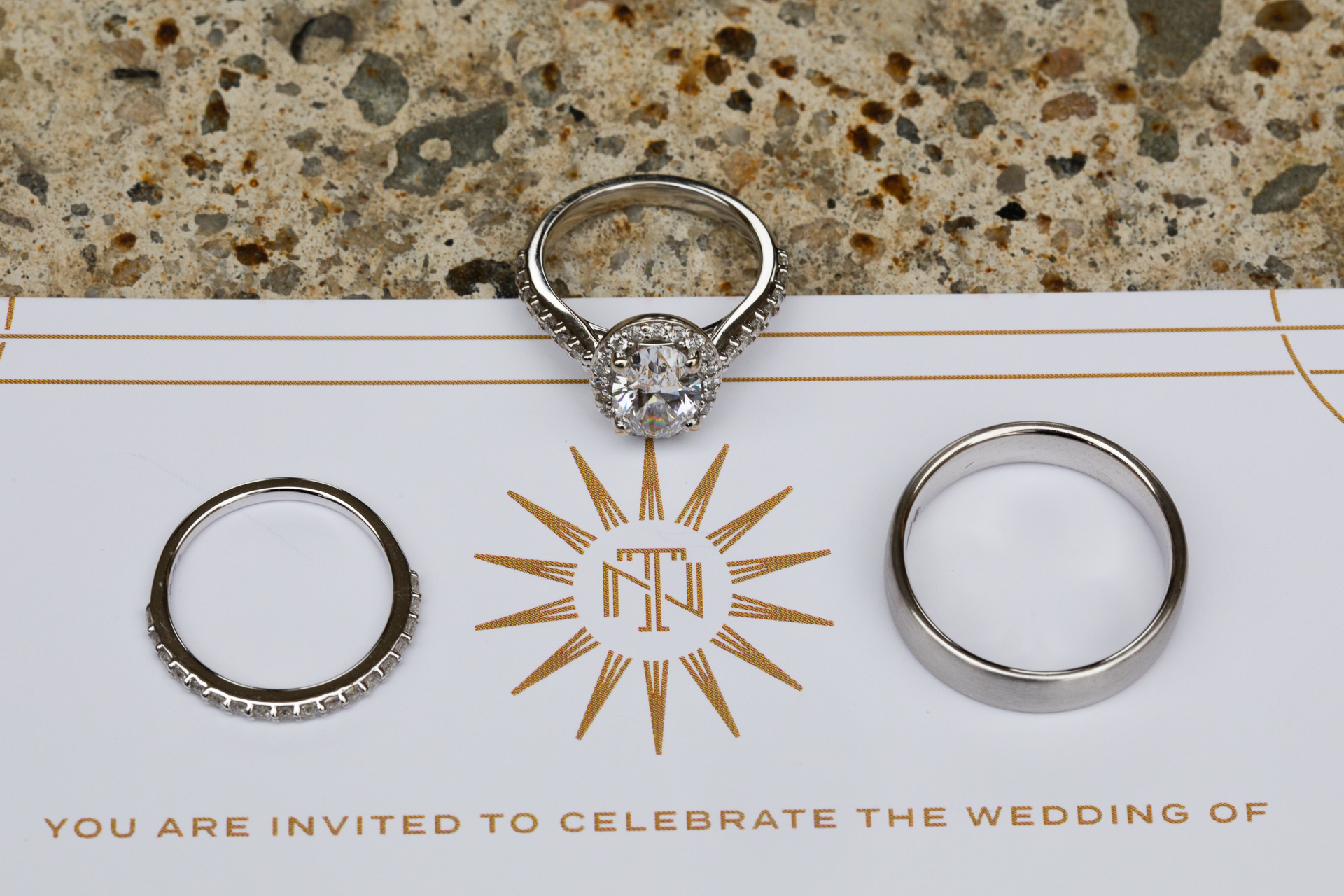 Wedding rings and custom invitation