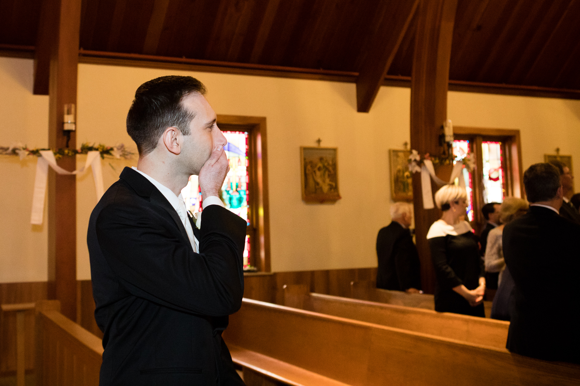 Groom excited for bride walking down the aisle
