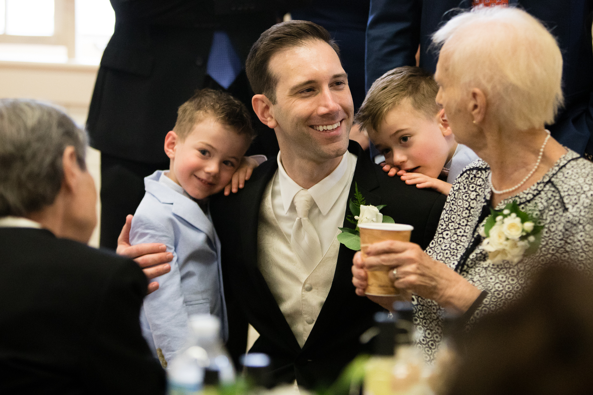 Groom with nephews and grandmother
