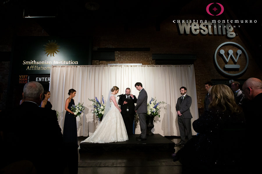 Bride and Groom at Wedding Ceremony in Great Hall with Cream Linen Backdrop Drape
