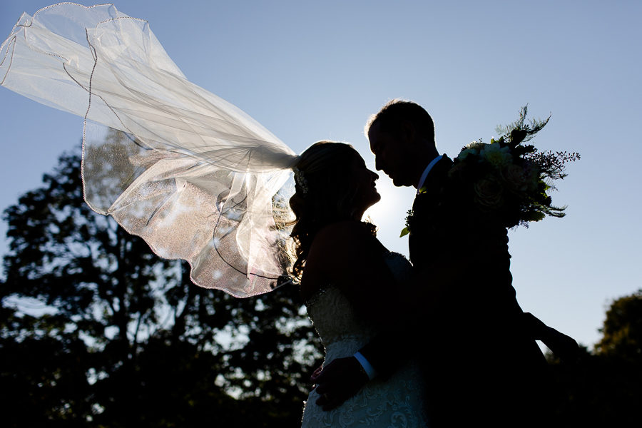 Bride and Groom Silhouette with Veil Flying