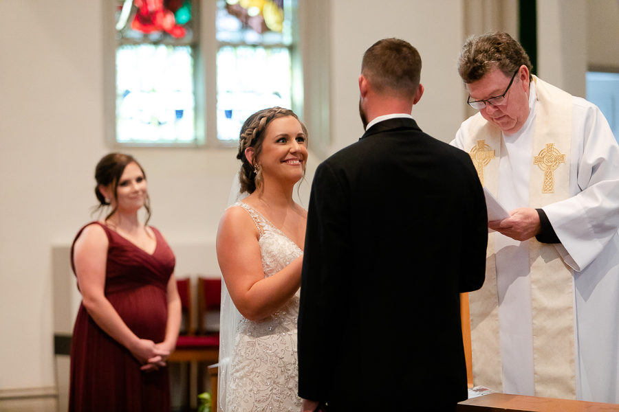 Bride and groom exchange wedding vows Duquesne University Chapel Pittsburgh