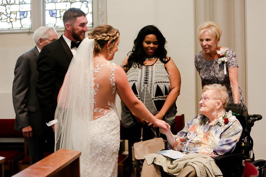 Bride and groom greet grandmother after wedding