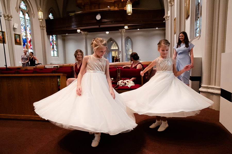 Flower girls twirling in the church