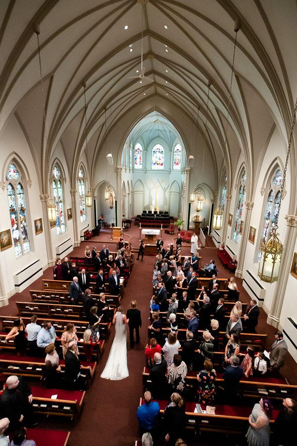 Bride walking down the aisle at Duquesne University Chapel