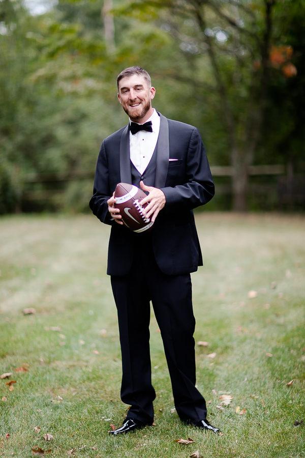 Groom with football