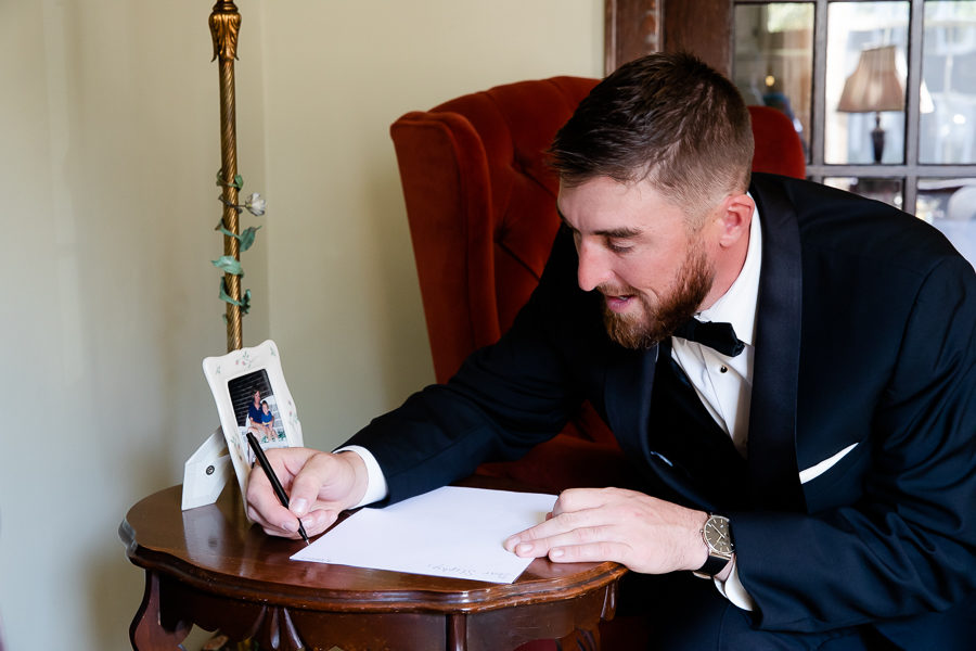 Groom writing card