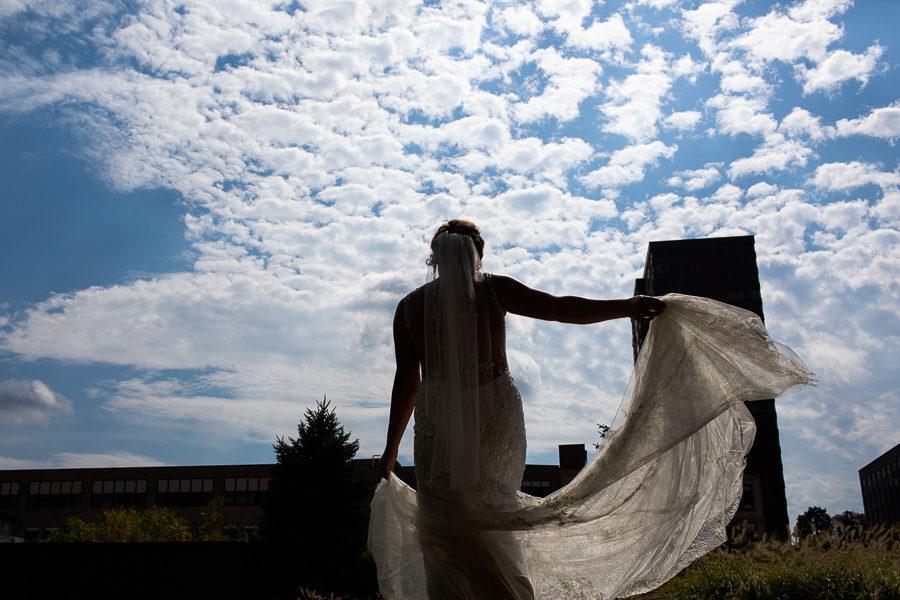 Bride twirling Justin Alexander Gown