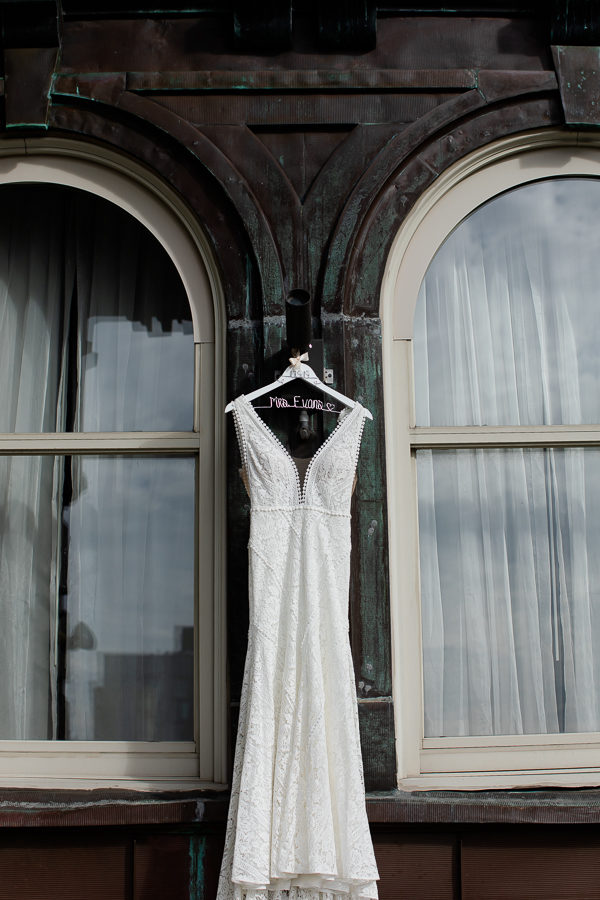 Wedding Gown from Luna Boutique Hanging on Renaissance Pittsburgh Hotel Balcony